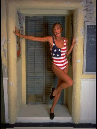 Model Standing in Doorway Modeling Ralph Lauren's Cotton and Lycra One Piece Flag Bathing Suit by Ted Thai