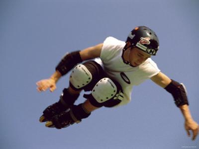 Teenager Inline Skating in Mid-Air
