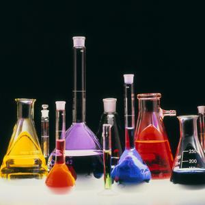 Assortment of Laboratory Flasks Holding Solutions by Tek Image