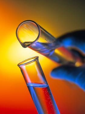 Measuring Cylinder Pouring Fluid Into a Test Tube by Tek Image