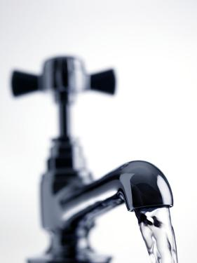 Water Running From a Tap by Tek Image