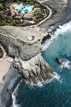 https://imgc.allpostersimages.com/img/posters/tenerife-la-caleta-playa-de-la-enramada-costa-adeje-volcano-coast_u-L-Q11YO0X0.jpg?p=0