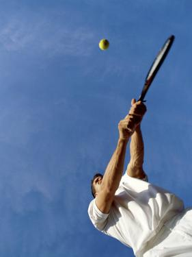 Tennis Player with Blue Sky