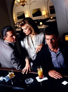 TEQUILA SUNRISE, 1988 directed by ROBERT TOWNE Kurt Russell, Michelle Pfeiffer and Mel Gibson (phot