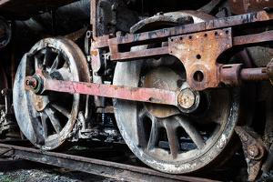 Rusty Wheels of Old Steam Locomotive close Up by tereh