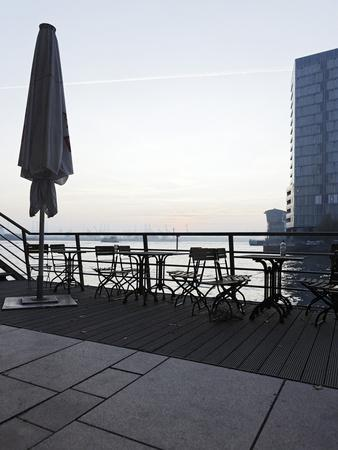 https://imgc.allpostersimages.com/img/posters/terrace-at-the-elbufer-fog-in-the-harbour-holzhafen-hanseatic-city-of-hamburg-germany_u-L-Q11YGFT0.jpg?p=0