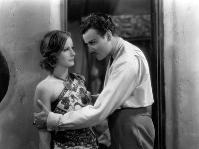 https://imgc.allpostersimages.com/img/posters/terre-by-volupte-wild-orchids-by-sidney-franklin-with-greta-garbo-and-nils-asther-1929-b-w-photo_u-L-Q1C24WA0.jpg?artPerspective=n