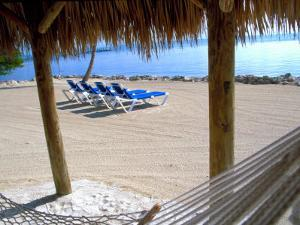Beach Hut and Chairs, South Beach, Miami, Florida, USA by Terry Eggers