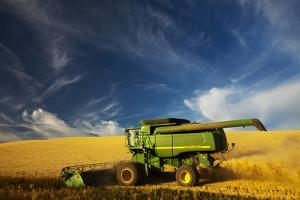 Combine Harvesting Wheat, Palouse Country, Washington, USA by Terry Eggers