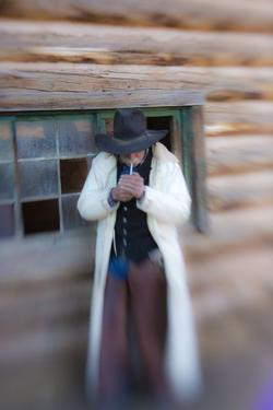 Cowboy Lighting a Cigarette by Terry Eggers