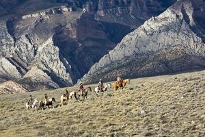 Cowboys and Cowgirls Riding along the Hills of the Big Horn Mountains by Terry Eggers
