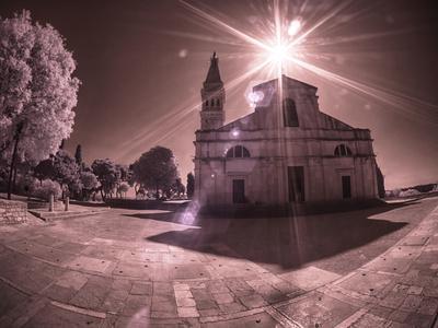 Croatia, Rovinj. The Church of St. Euphemia with morning sun streaming through