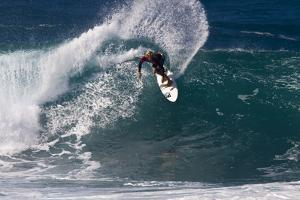 Hawaii, Oahu, Surfers in Action at the Pipeline on the Coast by Terry Eggers