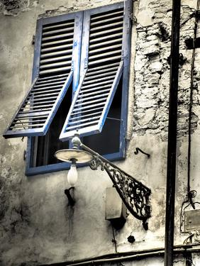 Italy, Pisa. Double windows and lamp on old building by Terry Eggers