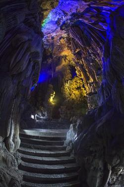 Multi Colored Lights in the Reed Flute Cave by Terry Eggers