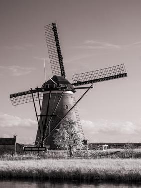 Netherlands, Kinderdijk. Windmills at sunset in Kinderdijk by Terry Eggers