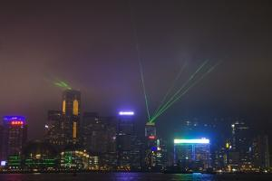 Nightly Light Show of the City of Hong Kong Draped in Fog by Terry Eggers