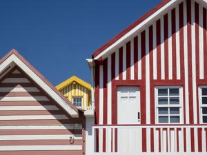 Portugal, Costa Nova. Colorful houses Palheiros striped homes by Terry Eggers