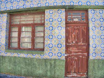 Portugal, Costa Nova. Colorful houses Palheiros striped homes