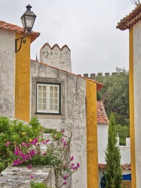 Portugal, Obidos. Graphic buildings inside the walled town by Terry Eggers