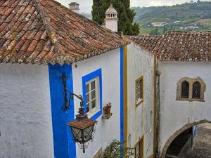 Portugal, Obidos. Graphic buildings inside the White walled town by Terry Eggers