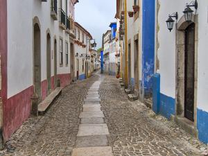 Portugal, Obidos. View looking down the main shopping street by Terry Eggers