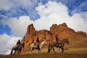Riders Passing under the Red Rock Hills of the Big Horn Mountains by Terry Eggers