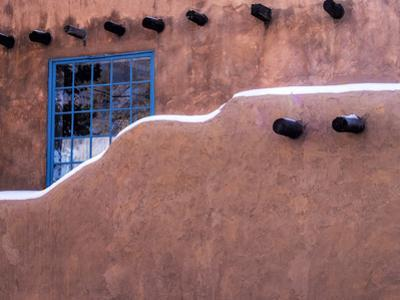 USA, New Mexico, Sant Fe, Adobe structure with protruding vigas and Snow by Terry Eggers