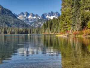 Washington State. Cooper Lake in Central Washington, Cascade Mountains reflecting in calm waters. by Terry Eggers