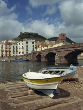 Boats Beside a Bridge over the Temo River at Bosa on the Island of Sardinia, Italy, Europe by Terry Sheila