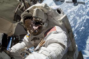Astronaut Barry Wilmore Works on Upgrades on the Exterior of the Iss by Terry Virts
