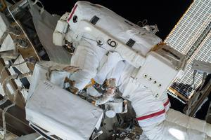 Astronaut Installs Communication Cables Outside the Iss by Terry Virts