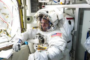 Astronaut Suits Up to Go on a Spacewalk Outside the Station by Terry Virts