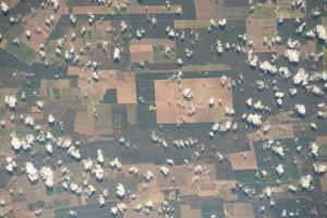 Cotton-Ball Clouds Dot the Rural Farmlands by Terry Virts