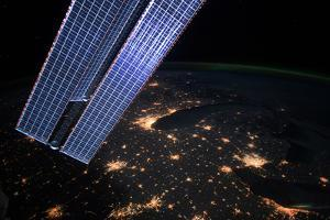 The Great Lakes Region, Visible Past Part of the Space Station, Is Aglow with City Lights by Terry Virts