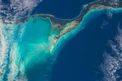 The Islands of the Caribbean Sea are Outlined in Turquoise by Terry Virts