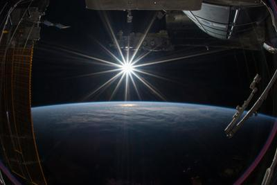 The Sun Rising over Earth from the Iss by Terry Virts