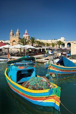 Marsaxlokk Harbor and Church,Malta. by Terry Why