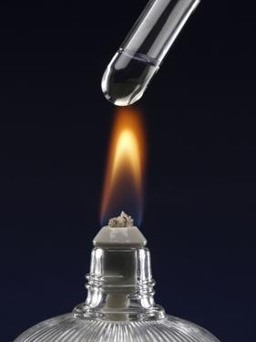 Test tube with liquid, over flame