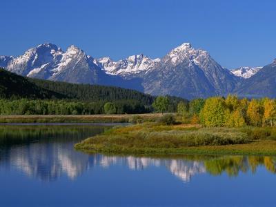https://imgc.allpostersimages.com/img/posters/teton-mountain-range-reflected-in-the-snake-river_u-L-PZKOWJ0.jpg?p=0