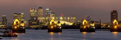 https://imgc.allpostersimages.com/img/posters/thames-flood-barrier-with-docklands-and-canary-wharf-panorama-from-woolwich_u-L-PWFBHB0.jpg?p=0