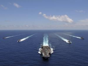 The Aircraft Carrier USS Abraham Lincoln Leading a Formation of Ships