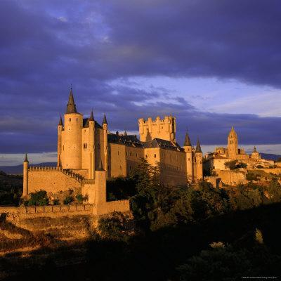 https://imgc.allpostersimages.com/img/posters/the-alcazar-and-cathedral-at-sunset-segovia-castilla-y-leon-spain_u-L-P2QTV30.jpg?artPerspective=n