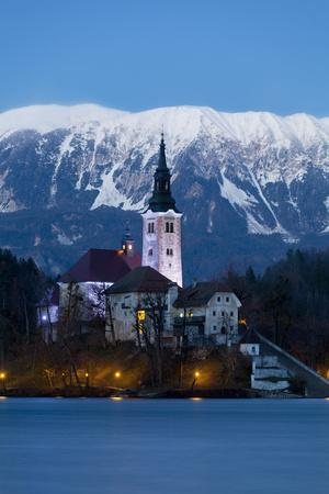 https://imgc.allpostersimages.com/img/posters/the-assumption-of-mary-pilgrimage-church-on-lake-bled-at-dusk-bled-slovenia-europe_u-L-PWFF5J0.jpg?artPerspective=n