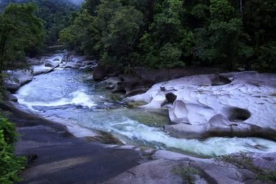 https://imgc.allpostersimages.com/img/posters/the-babinda-boulders-is-a-fast-flowing-river-surrounded-by-smooth-boulders-queensland-australia_u-L-Q12T73O0.jpg?p=0