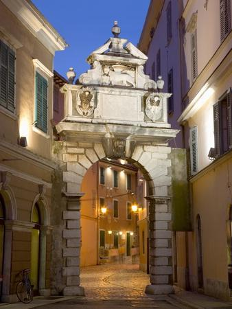 https://imgc.allpostersimages.com/img/posters/the-balbi-arch-and-pedestrianized-grisia-illuminated-at-dusk-rovinj-rovigno-istria-croatia_u-L-PFNTI10.jpg?p=0