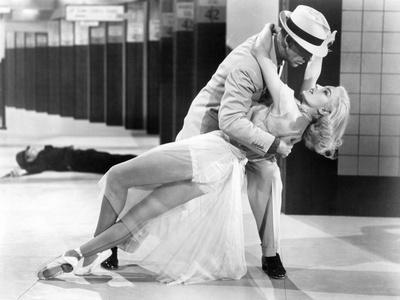 https://imgc.allpostersimages.com/img/posters/the-band-wagon-from-left-fred-astaire-cyd-charisse-1953_u-L-PTA2TK0.jpg?artPerspective=n