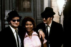 THE BLUES BROTHERS, 1980 directed by JOHN LANDIS Aretha Franklin between John Belushi and Dan Aykro