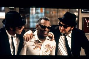 THE BLUES BROTHERS, 1980 directed by JOHN LANDIS Ray Charles between Dan Aykroyd and John Belushi (