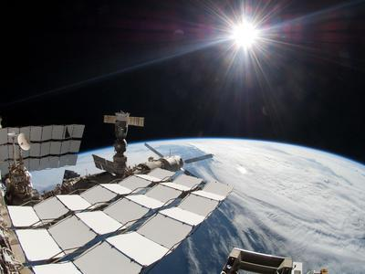 https://imgc.allpostersimages.com/img/posters/the-bright-sun-a-portion-of-the-international-space-station-and-earth-s-horizon_u-L-PJ284F0.jpg?artPerspective=n